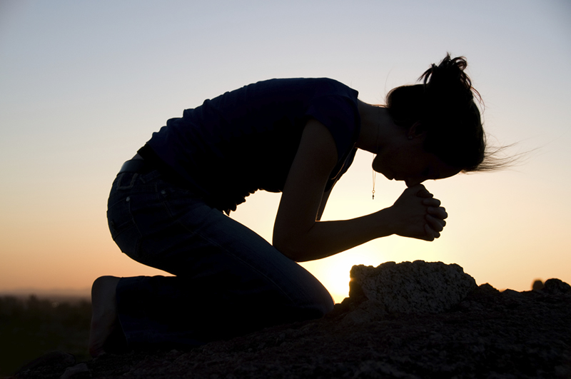 A Praying Women …….On Bended Knees